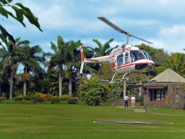 Arrivée en hélicoptère au Royal Palm Hotel