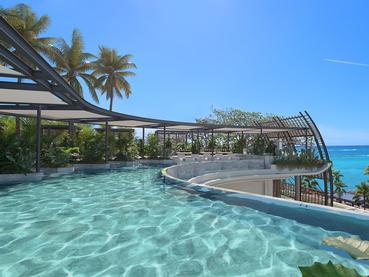 La piscine du LUX* Grand Baie surplombant l'océan